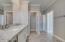 Bathroom #3 with Granite Countertops, Walk In Shower, Vanity, and tile laid in a Herringbone Pattern.