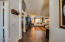 """Upon entry you are welcomed into the Heart of the Home where you will find a spacious open concept living floor plan w vaulted ceilings, picturesque windows, plantation shutters, & 18"""" tile."""