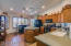 Kitchen features an island, breakfast nook, and abundant counter and cabinet space.