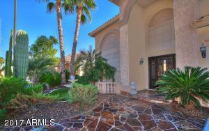 Greet your guests here! Lush landscaping and flawless flagstone at inviting path to front door.