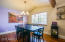 . Upon entry you will notice the open concept floor plan, wood beam detail, and large picturesque windows throughout.