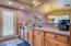 The kitchen was updated in 2013 and boasts stainless steel appliances.