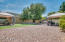 The backyard features mature landscape, a spa, RV gate, and room for your toys!