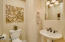 Cozy and private half bath with pedestal sink.