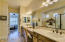 Desirable master en suite with dual vanities and sinks with upgraded cabinets and countertops.
