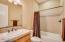 Upgraded guest bathroom with stunning tiling and backsplash.