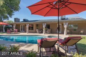 CHECK OUT THE HUGE BACK COVERED PATIO WITH CABBANA DRAPES!
