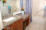 Master bath has tub, shower, rich wood cabinetry, granite counters and nickel fixtures throughout.