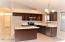 Kitchen with brand new cabinets, modern quartz countertop, stainless appliances, sink and faucet.