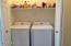 On one side of the hallway is the laundry room. Washer and Dryer convey with full price offer!