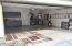 Here is another view of the garage showing space for two vehicles as well as additional storage. What a clean, beautiful epoxy floor.