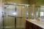 Master bathroom shower with grab bars
