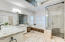 Elegant master bath with floor to ceiling shower & jetted garden tub