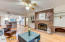 Brick fireplace & built ins in cozy family room