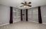 Expansive great room with full motion television mount on the wall.