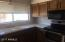 Kitchen comes complete with refrigerator, microwave, 6 mo old black & stainless smooth top range & dishwasher. Newer kitchen sink.