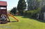 huge, huge lot and the swing set goes with your new home. Irrigation for that low water bill.