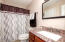 Bathroom access from laundry center and master bedroom.