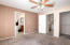Master bedroom has large walk-in closet and bathroom access.
