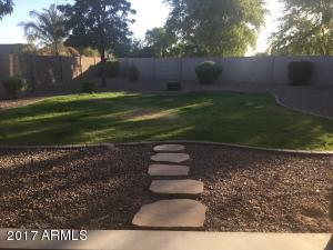 Flagstone Pavers to Backyard Large Enough for a Pool and Play Area for Family