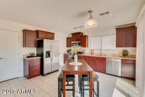 Updated eat-in Kitchen with newer staggered cabinetry and granite counter tops.