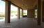 COVERED PATIO OFF OF THE FAMILY ROOM
