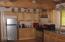 Maple cabinets; full log beams