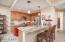 Kitchen with under cabinet lighting and stone backsplash