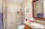 Large Shower with frameless shower door.