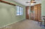another good sized bedroom with beautiful built ins and wainscoating. Character all around here.