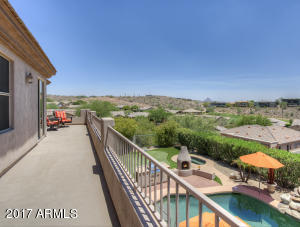 View from master balcony overlooking pool, Firerock and Redrock Mountain.