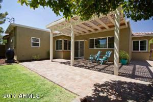 Large paver patio has lots of room. Enjoy filtered sun with the arbor style patio cover.
