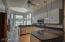 Granite kitchen with white cabinetry & halogen lights