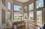 Eat in sunny kitchen with door to veranda & french paned windows floor to ceiling