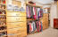 Large Master closet with builtin drawers and shoe racks
