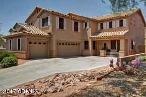 Exquisite home in Dynamite Mountain Ranch. Desert Landscaping, 3 car garage, cozy front porch