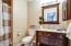 Upgraded vanity, mirror and medicine cabinet.