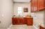 Large laundry with sink, loads of cabinets. Dryer is plumbed for gas or electric. +++