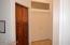 Linen Closet before Main Suite -Double Doors closed.
