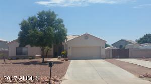 Great curb appeal with low maintenance desert landscaping