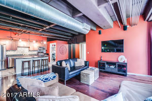 Industrial Style Masterpiece with hardwood flooring, exposed brick and ductwork, shaker style cabinetry and amazing 1930's architecture.