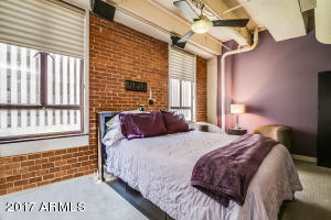 Master Bedroom with Exposed Brick and Ductwork, HUGE Walk in Closet, and Private Bathroom.