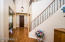 Impressive grand entry opens to 2nd story and semi-spiral staircase