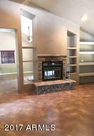 2 way fireplace in fam rm w/built ins, vaulted ceilings & clerestory windows make this room a delightful place to hang out!
