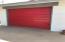 Detached garage red door. The door is vintage, but it opens so so easy...