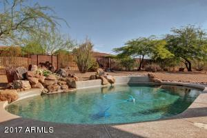 Your very own private resort for all Seasons! Beautiful Play Pool with Feature Waterfall! Be sure to CLICK on the Virtual Tour!