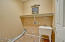 SPACIOUS INSIDE LAUNDRY ROOM WITH A WASH BASIN
