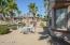 Kool decked courtyard with plenty of palms