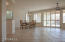 All timeless off white tile, laid at the diagonal, accent the large open space in the formal dining room and great room