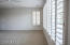 A oversize master suite with lots of plantation shutters provide great light